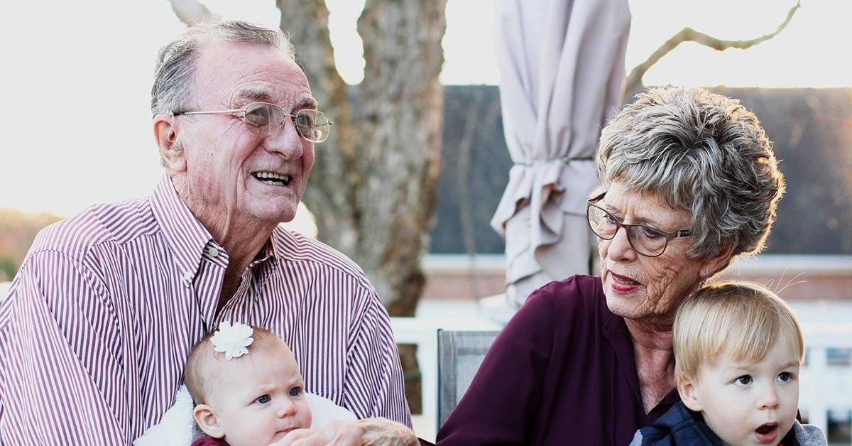 Grand Parents holding grand children